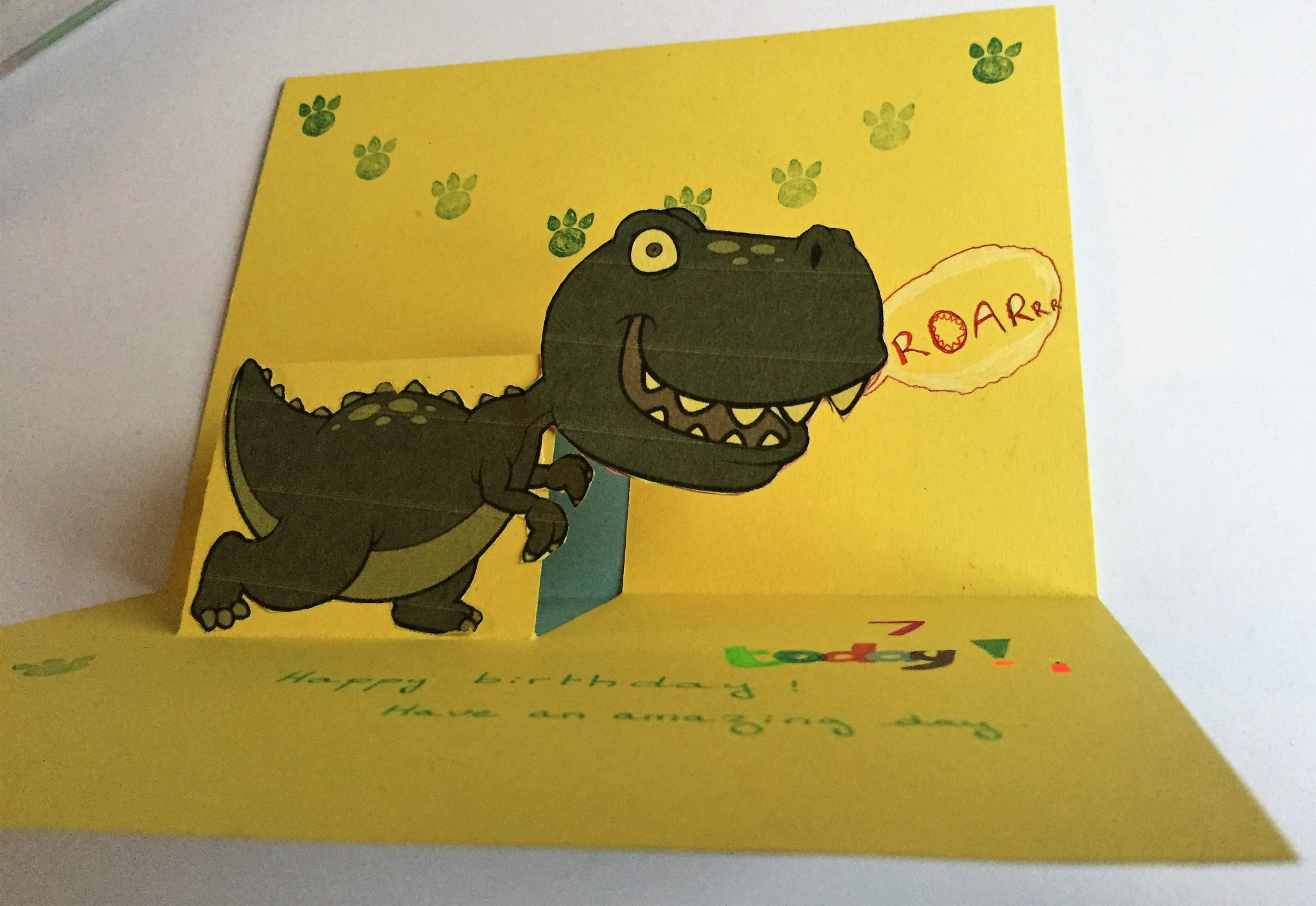 How to make a pop up card Model - How to make a pop up card: Dinosaur birthday card