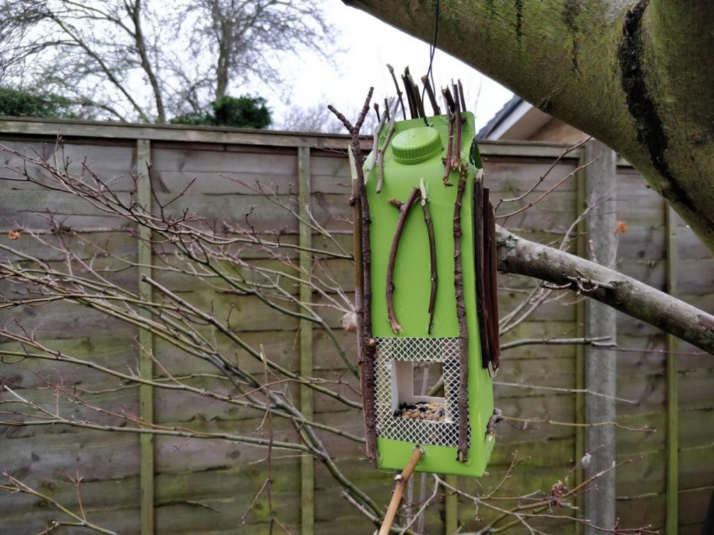 Easy DIY Bird Feeders from recycled materials - Step 6 Fixing the bird feeder to the tree